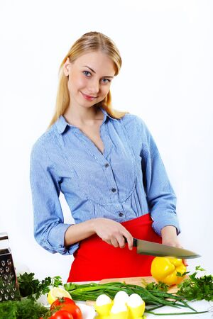 Young happy woman cooking fresh meal at home Stock Photo - 13198812