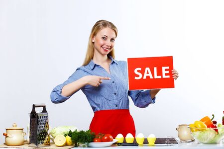 Young happy woman cooking fresh meal at home Stock Photo - 13197300