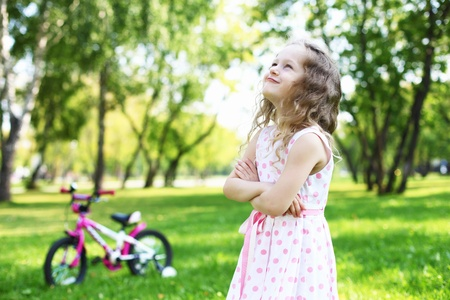 Little happy girl having fun in green summer park Stock Photo - 13201381