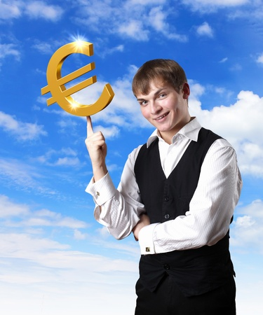 Young businessman with money symbols against blue skyy background photo