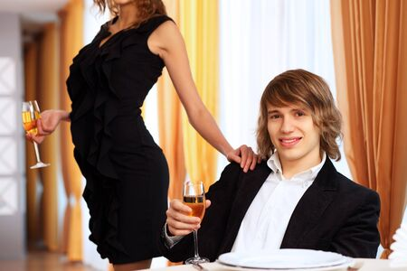 Portrait of a young handsome man sitting in restaurant photo