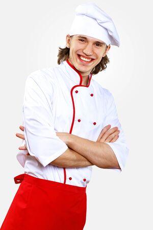 Portrait of a young cook in uniform preparing meal Stock Photo - 13199286