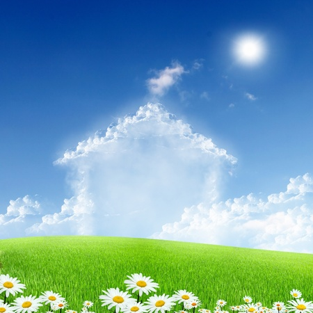 Picture of a house from white clouds against blue sky photo