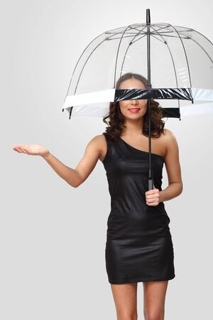 Studio portrait of woman in black dress with umbrella photo