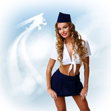 Young woman dressed in retro style with stewardess cap photo
