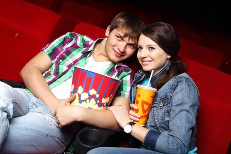 Young couple sitting in cinema and watching movie Stock Photo - 13225518