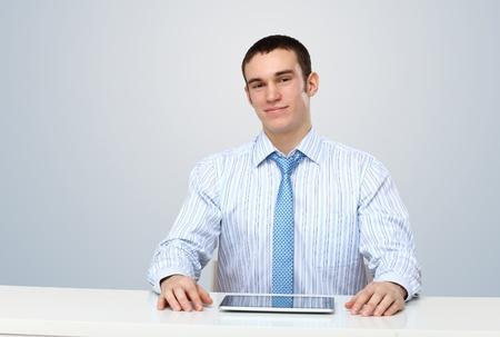 Portrait of a man in business wear making presentation photo