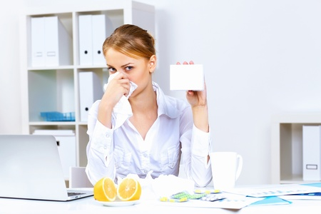 Young woman feeling unwell and sick in office Stock Photo - 13224068