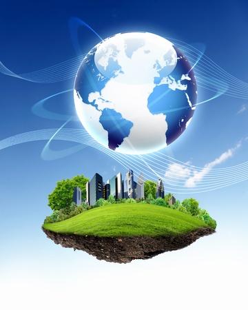 planeta verde: collage de paisaje verde de la naturaleza con el planeta Tierra por encima de ella Foto de archivo