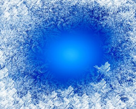 Blue frost winter background with white snowflakes photo