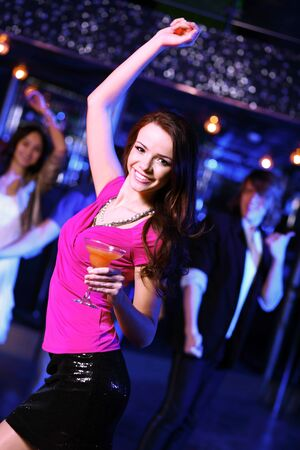 Young woman having fun and dancing at night club disco Stock Photo - 13223244