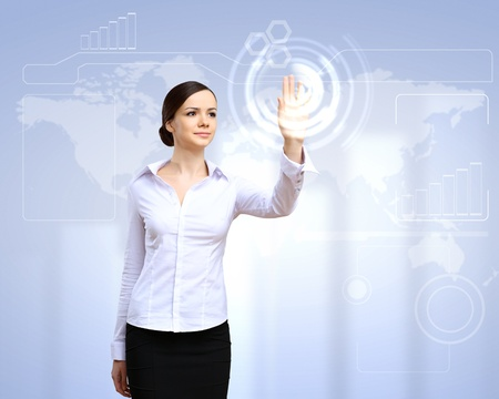 touch technology: Young woman in business wear with touchscreen technology background