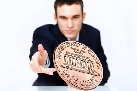 Person throwing a coin as symbol of risk and luck Stock Photo