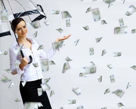 corporate greed: Collage with business woman under money rain with umbrella Stock Photo