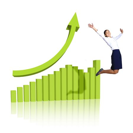 Young woman jumping up against financial charts photo