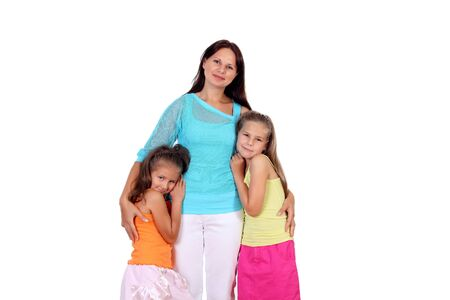 Mother standing with her two daughters in studio Stock Photo - 13227544
