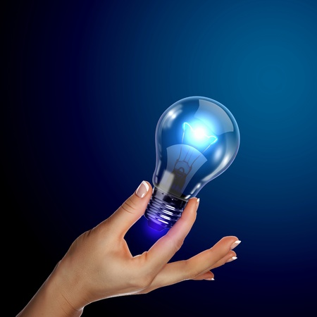 Human hand holding a shining electric bulb Stock Photo - 13227140