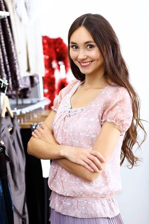 Portrait of young woman inside a store buying clothes Stock Photo - 13246965