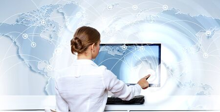 Business woman working with virtual digital screens photo