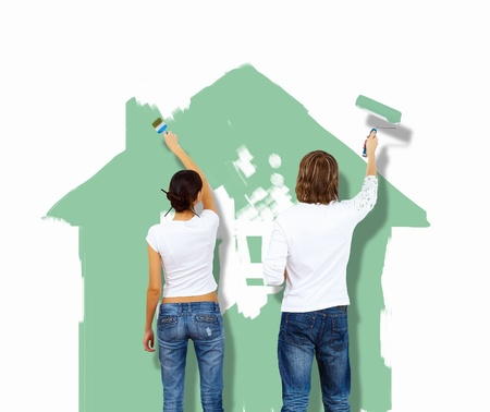 Young caucausian couple with paint brushes together Stock Photo - 13247577