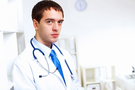 Young confident and friendly doctor in medical office Stock Photo - 13247616