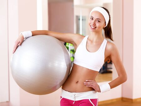 Young woman in sport wear doing sport in gym Stock Photo - 13247048