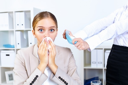Young woman feeling unwell and sick in office Stock Photo - 13247164