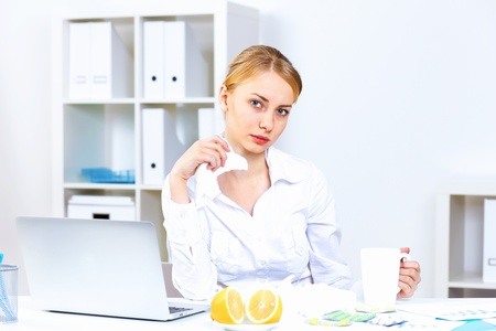 Young woman feeling unwell and sick in office Stock Photo - 13247570
