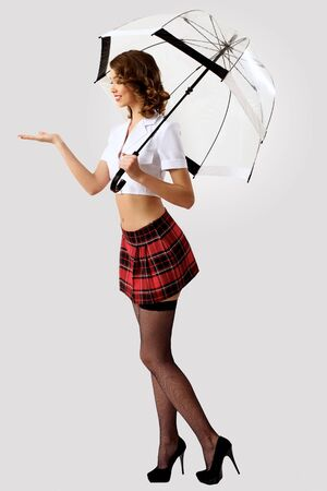 Young pretty woman dressed in retro style with umbrella photo