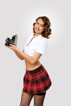 Young pretty woman dressed in retro style with camera photo