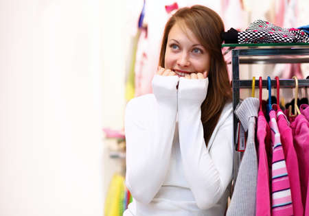 Portrait of young woman inside a store buying clothes Stock Photo - 13302737
