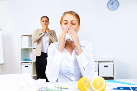 Young woman feeling unwell and sick in office photo