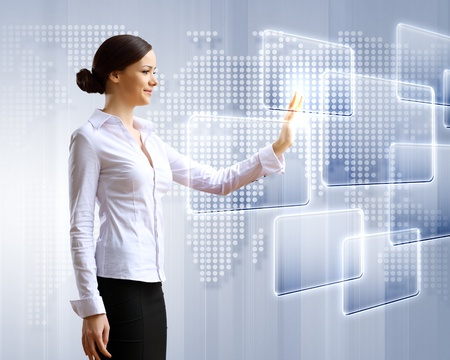 multimedia background: Young woman in business wear with touchscreen technology background