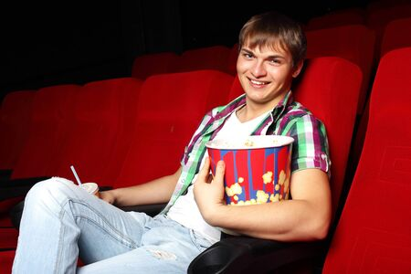 Young man sitting in cinema and watching movie Stock Photo - 13303067