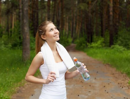Young woman doing sport outdoors in summer Stock Photo - 13306953