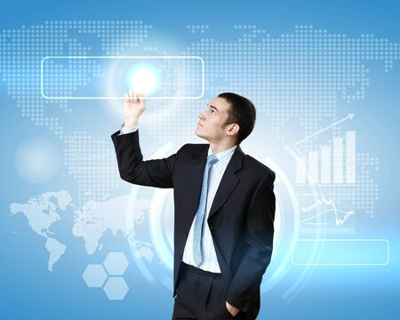 Businessman in suit working with touch screen technology photo