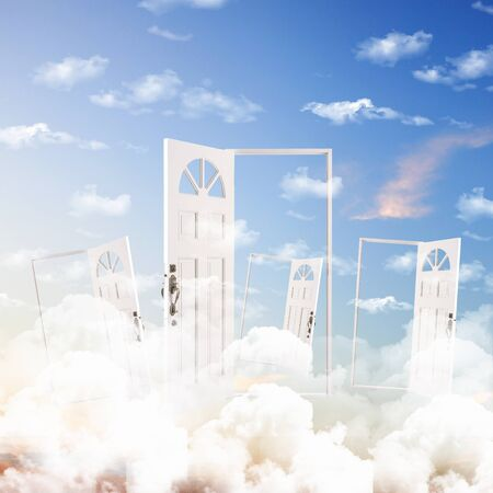 Picture of a white door against blue sky background photo