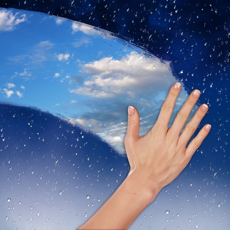 cleaner worker: Hand cleaning window with blue sky and white clouds