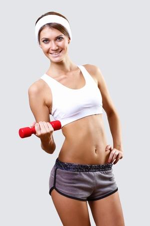 Young pretty woman in sport wear doing sport photo