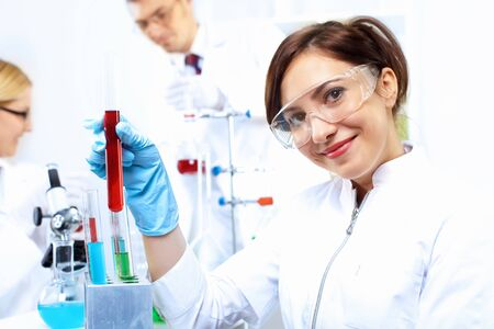 Scientist in uniform doing tests in laboratory photo