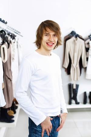 Young man in white sweater doing shopping photo