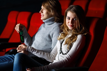 Young couple sitting in cinema and watching movie Stock Photo - 13307682