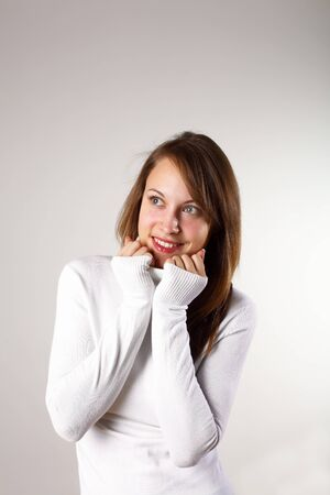 Studio portrait of young girl in white sweater Stock Photo - 13307615