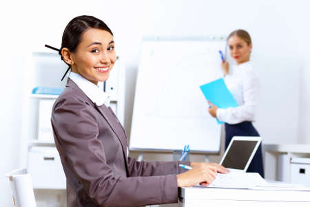 Young pretty woman in business wear working in office Stock Photo - 13383179