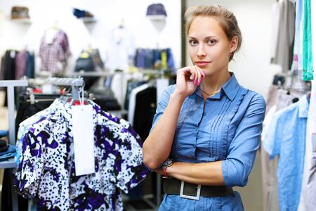 Young woman in a shop buying clothes Stock Photo - 13382850