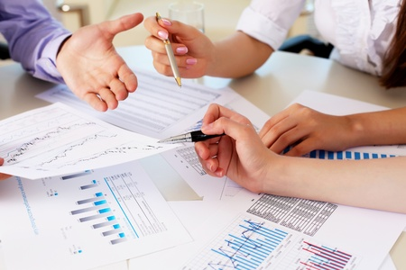 financial and business documents on the table and human hands Stock Photo - 13382995