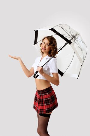 Young pretty woman dressed in retro style with umbrella Stock Photo - 13383195