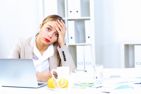 Young woman feeling unwell and sick in office Stock Photo - 13375407