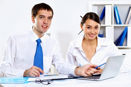 Two young business collegue working together in office photo