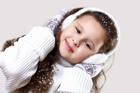 Cuty little girl in winter wear happy about new year photo